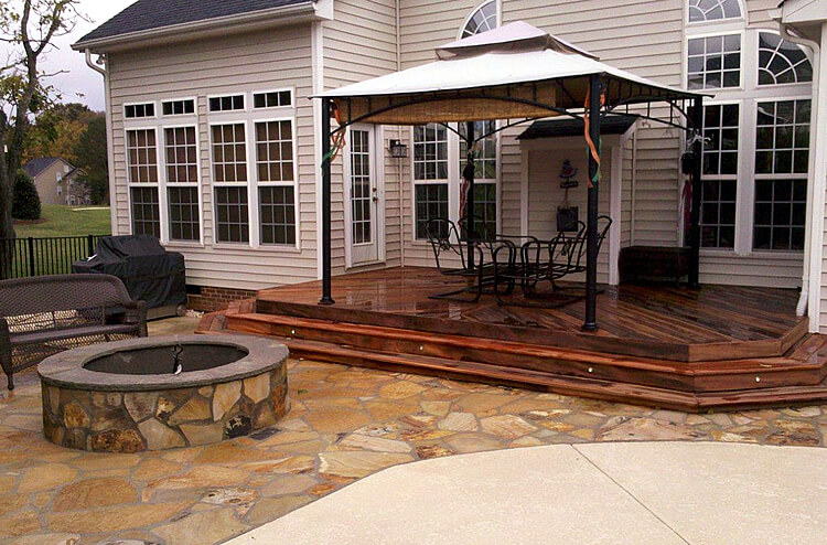 flagstone patio and Ipe deck with firepit