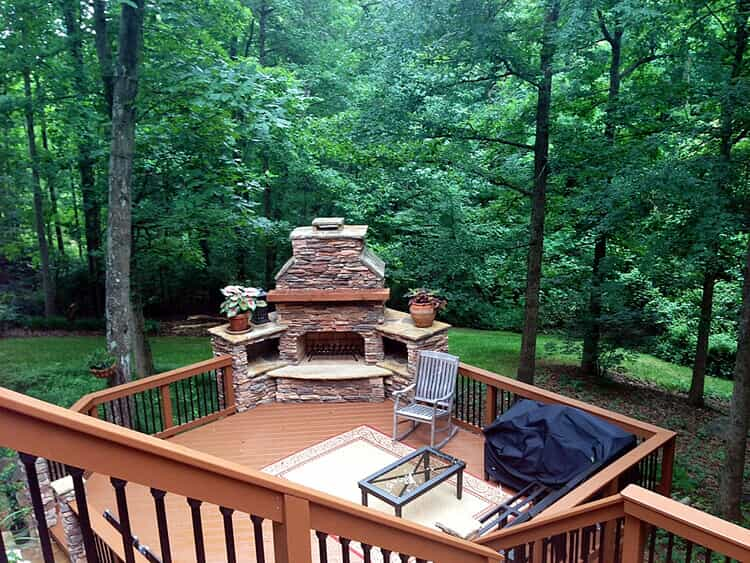 deck with built in fireplace and outdoor furniture