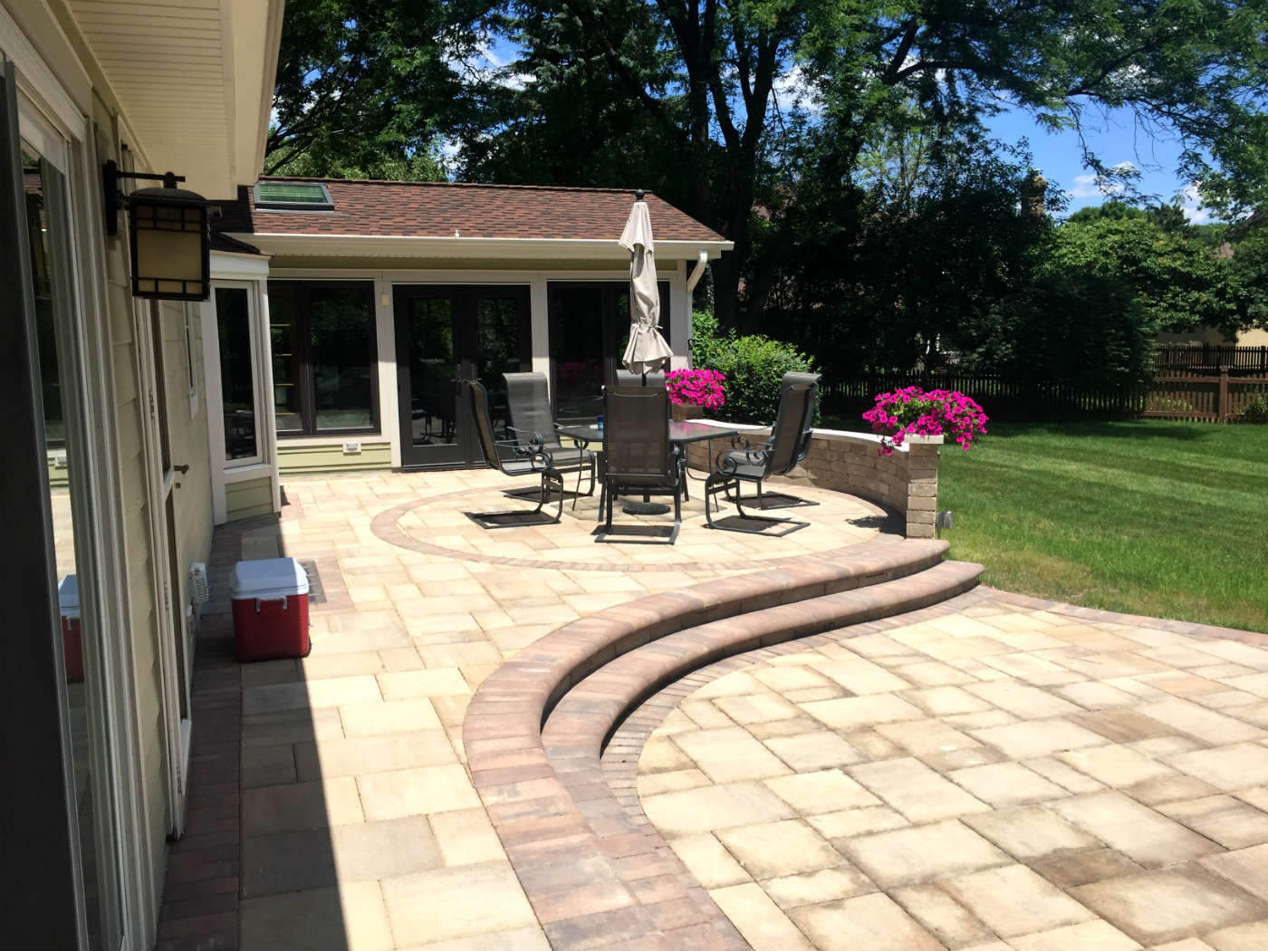 Multi-level Belgard patio with screened porch