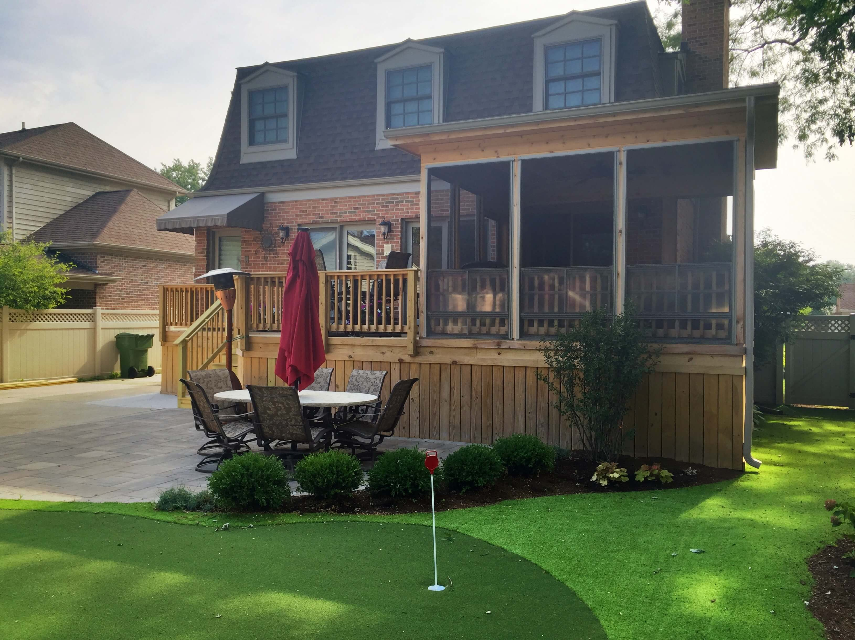 Back yard porch with mini golfing area
