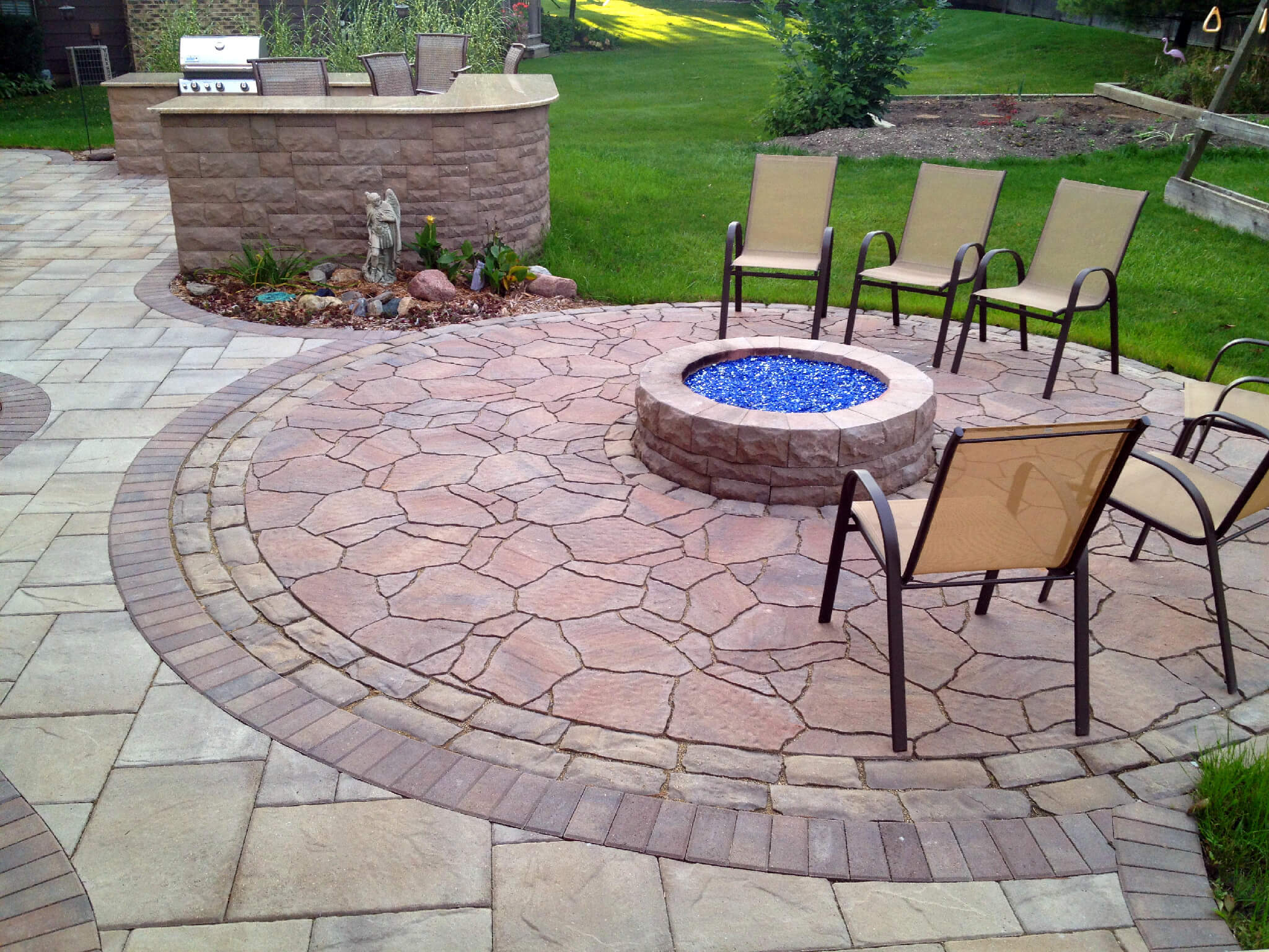 Patio with kitchen and fire pit