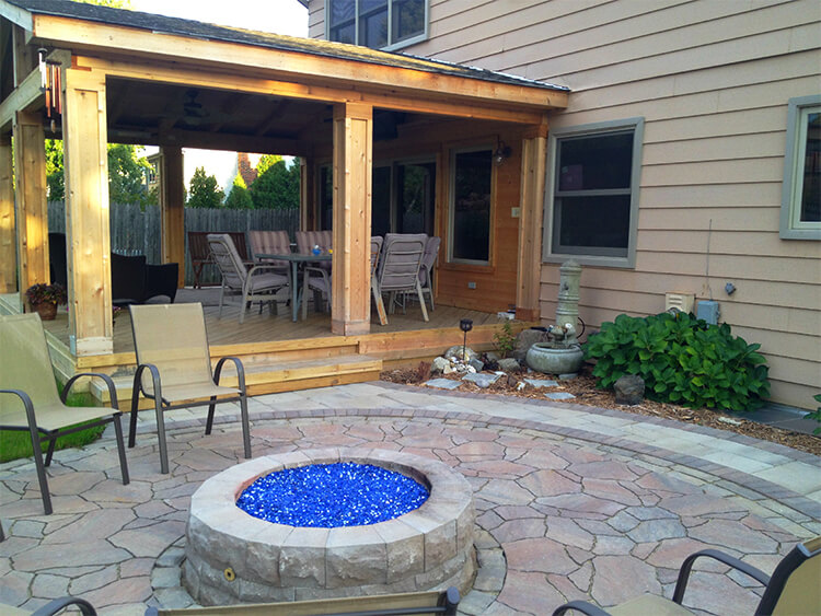 Custom open porch with patio and fire pit