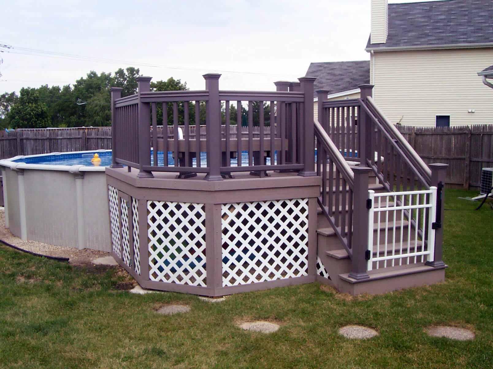Custom small above the ground pool deck