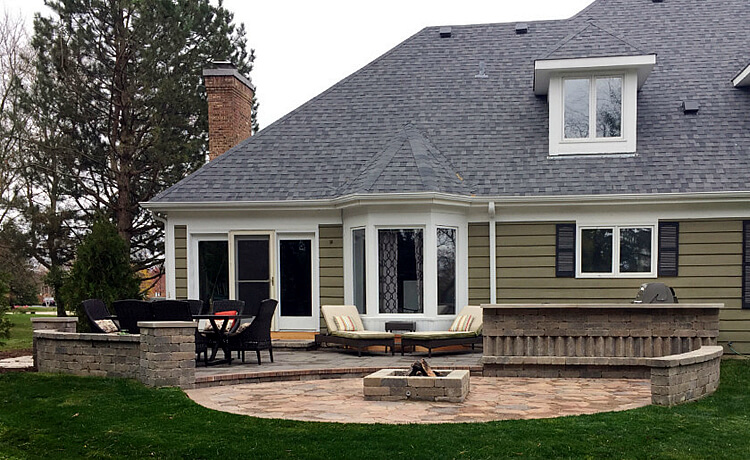 Custom multi level patio with outdoor kitchen and fire pit