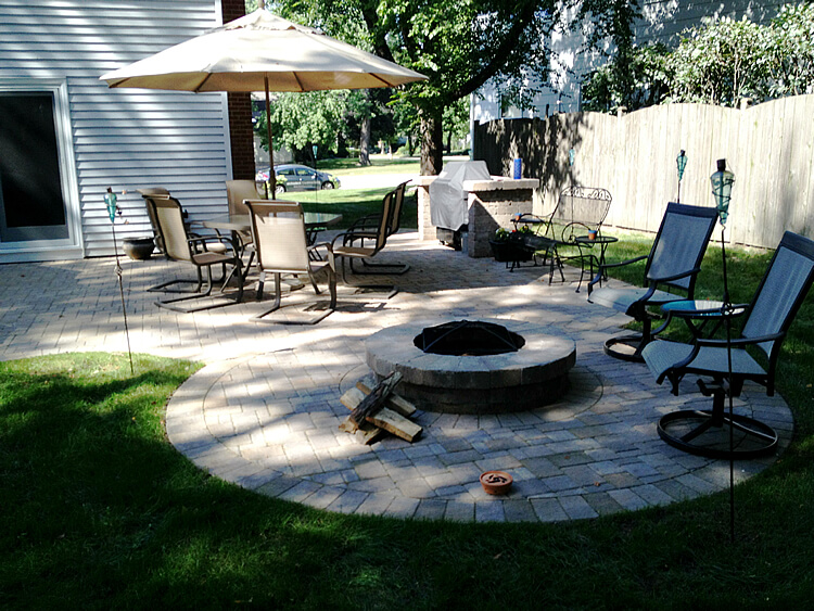 Custom expanded paver patio with fire pit