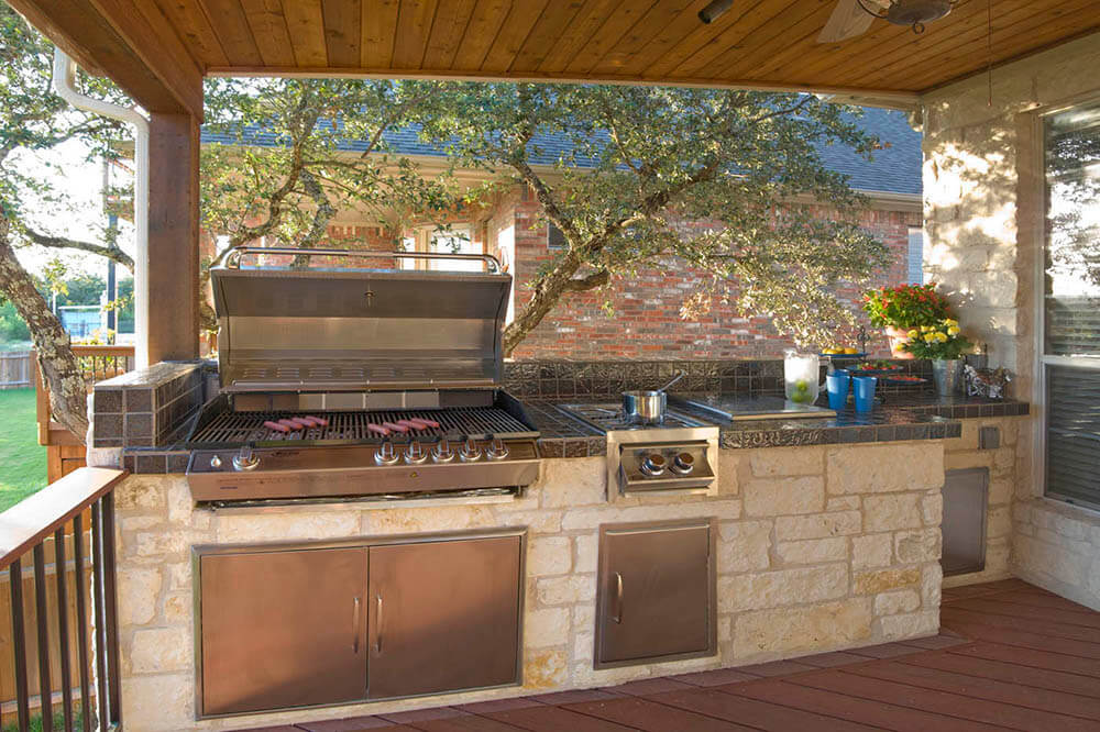 Custom outdoor kitchen with sausages on grill