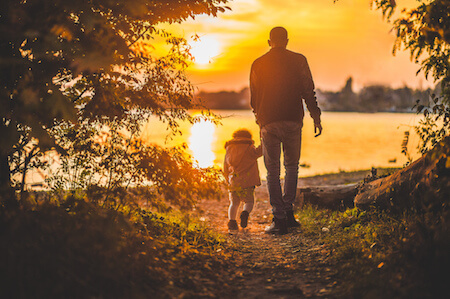 Father and child walking