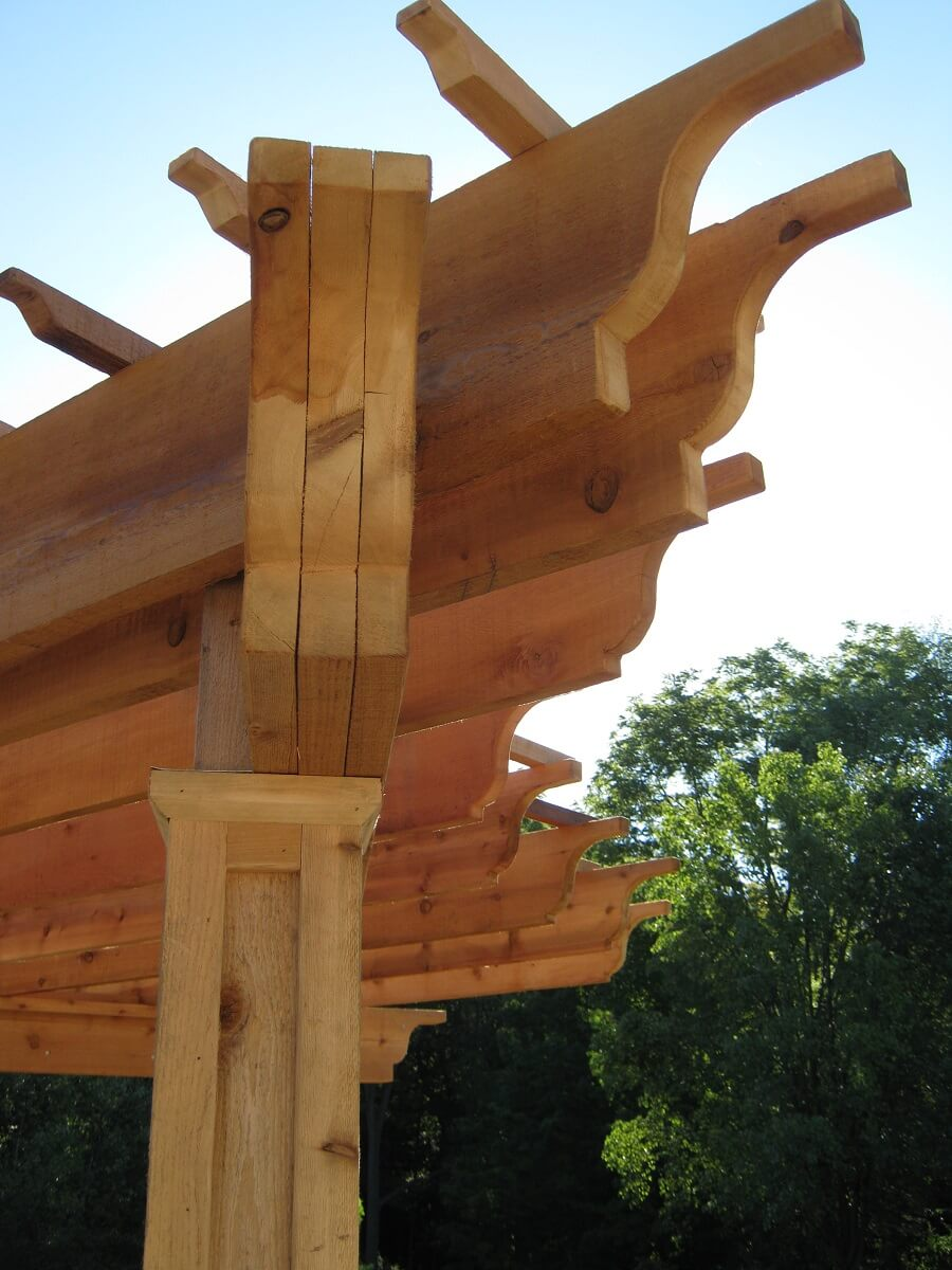 Close-up of pergola corner design, with ogee ends