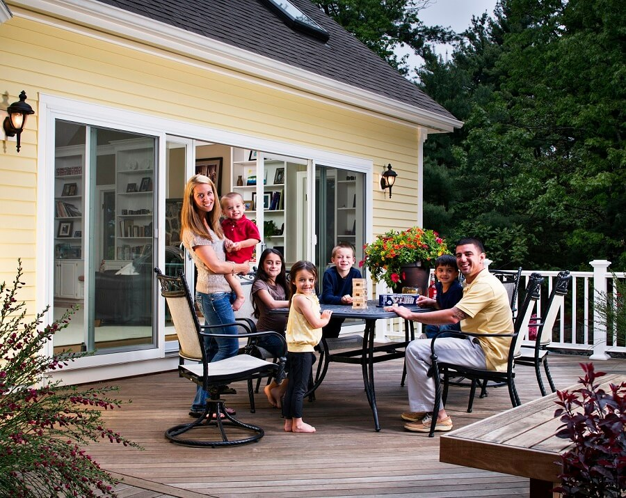wood deck with family hanging out