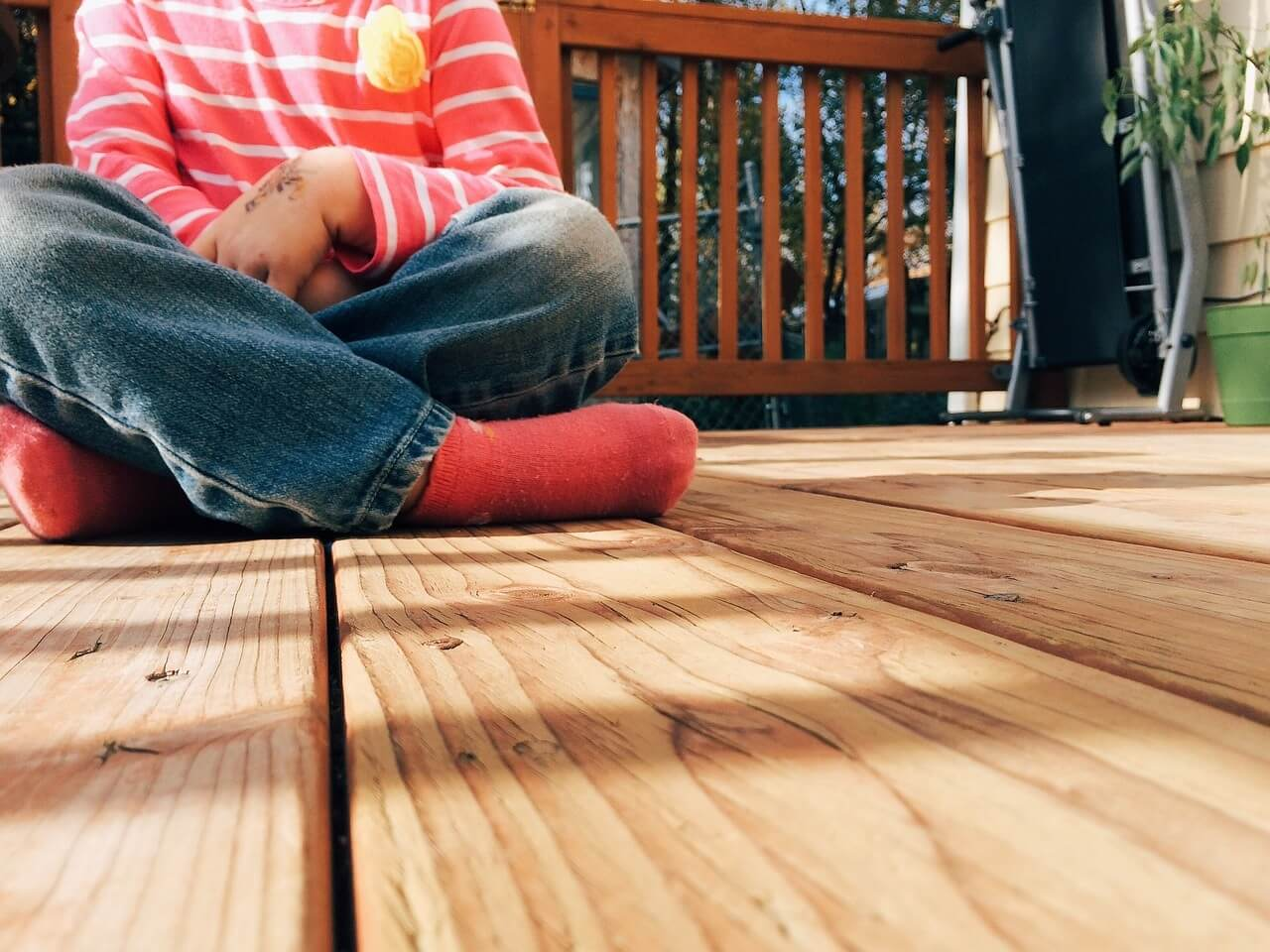 Kid sitting on deck floor