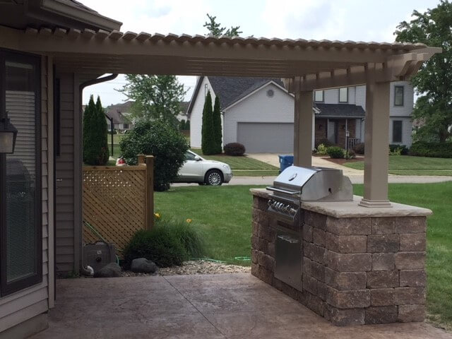 Custom patio with pergola and outdoor kitchen