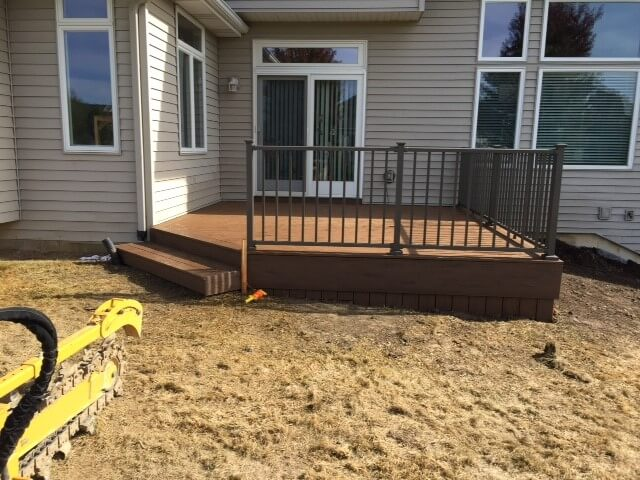 Custom low maintenance wood deck with railing