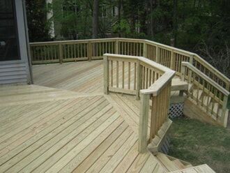 wood multi level deck with railings and stairs