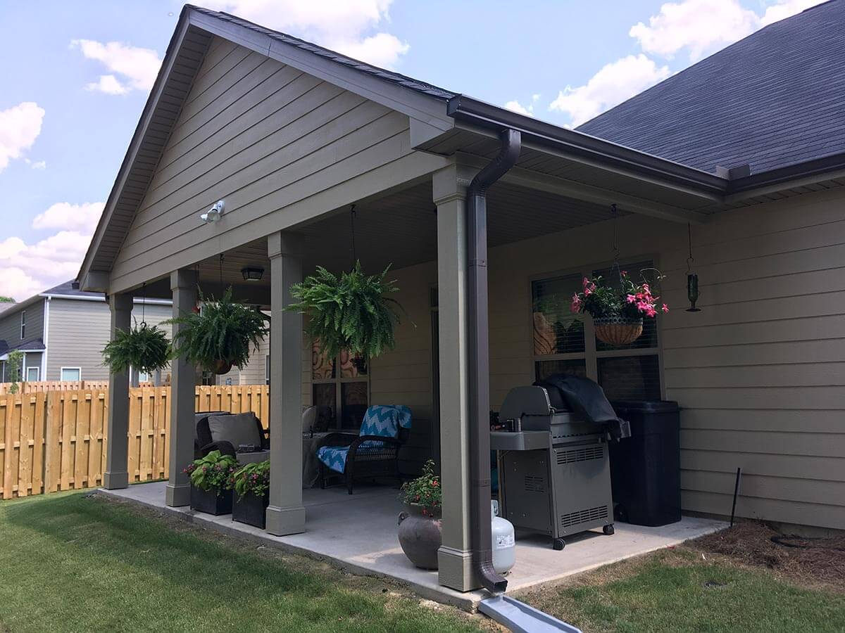 Custom covered porch with outdoor kitchen and plant decors