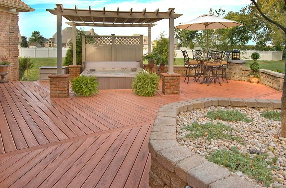Custom deck with hot tub and pergola