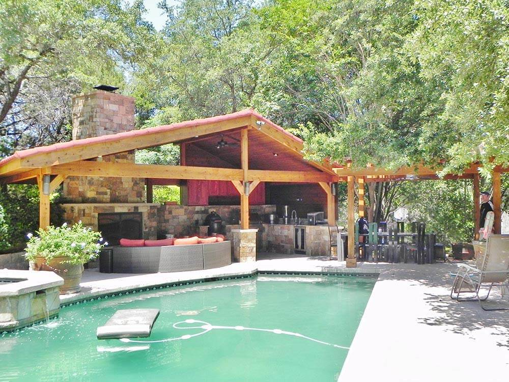 Custom poolside open porch with outdoor kitchen