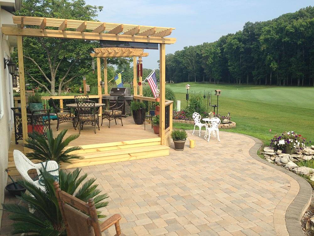 Custom backyard deck and patio with pergola