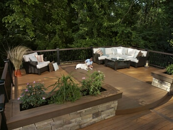 custom deck with planters and railing