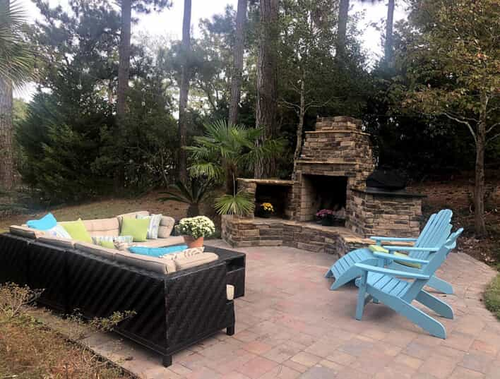 Patio with outdoor furniture and fireplace