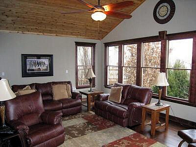 sunroom with leather couch