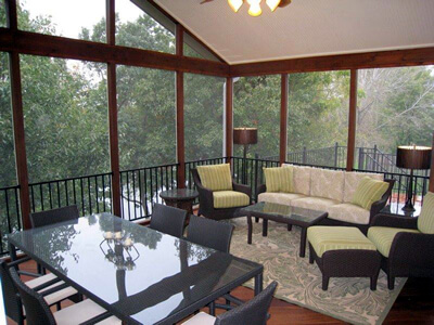 screened porch with couch and chairs