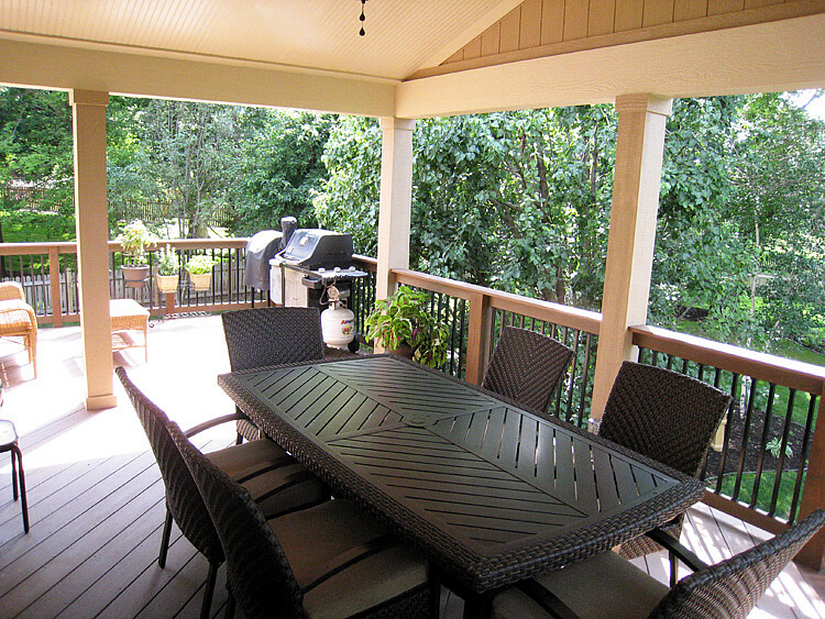 Dining area on covered porch and deck