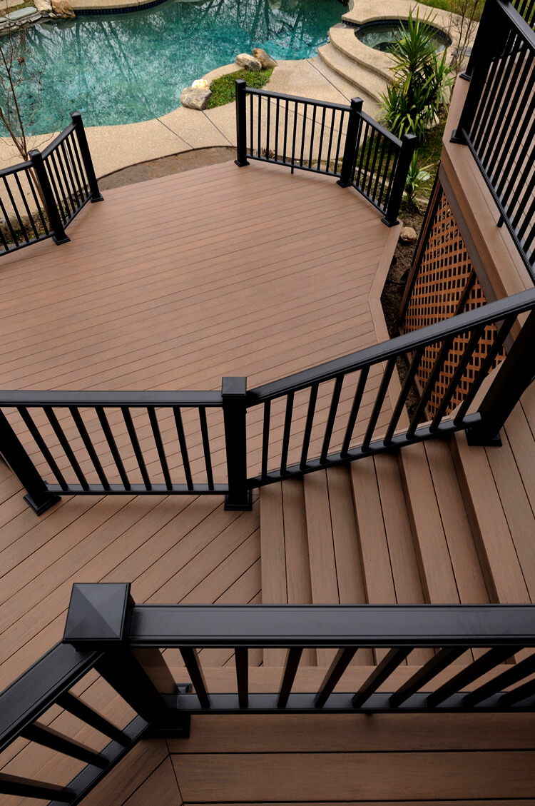 Poolside multi-level deck with railing
