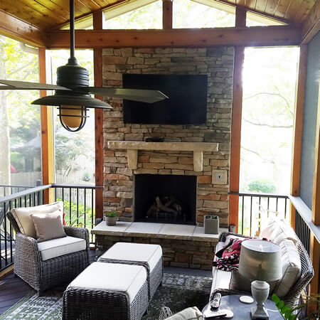 Custom outdoor fireplace on screened porch