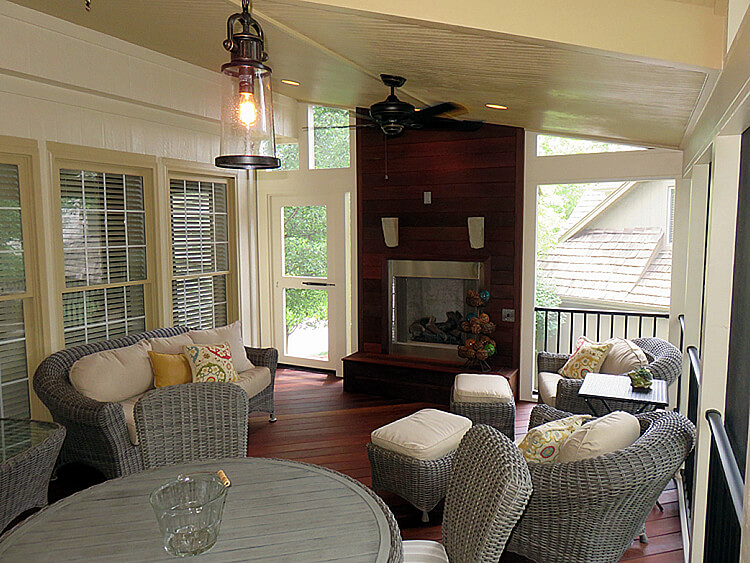 Cozy interior of custom sunroom with outdoor fireplace