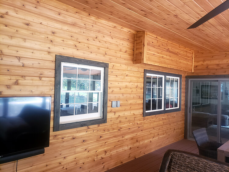 Screened porch with cedar wall