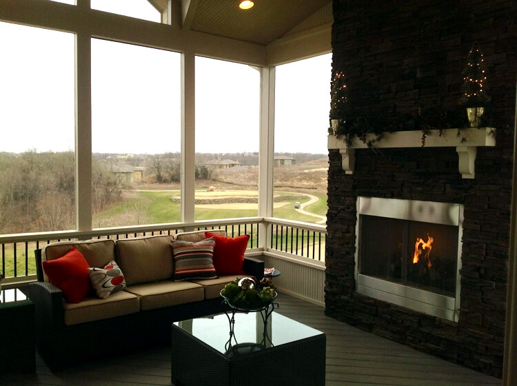 Cozy screened porch with outdoor fireplace