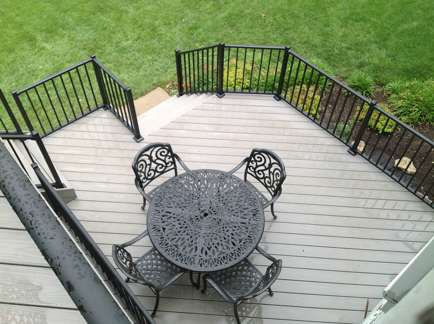 Seating area on wood deck with black metal railing