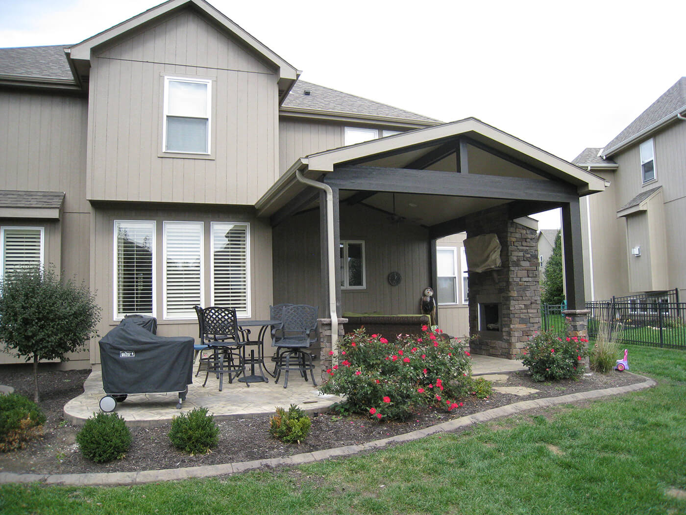 Custom patio and open porch with outdoor kitchen