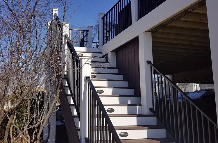 Custom deck staircase with railing and lighting