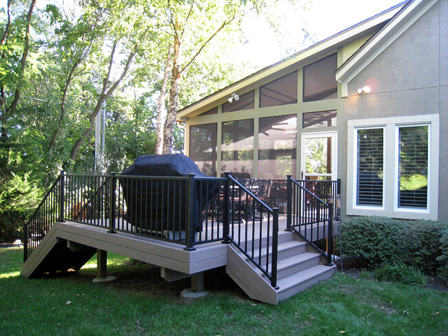 Custom screened porch and deck with outdoor kitchen