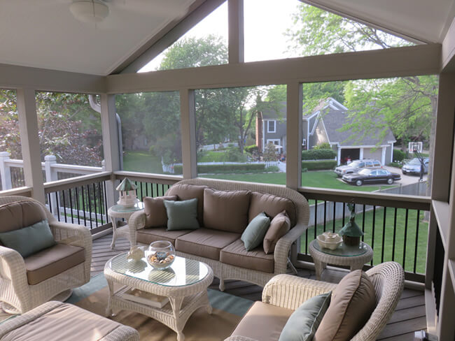 Cozy custom screened porch with backyard view