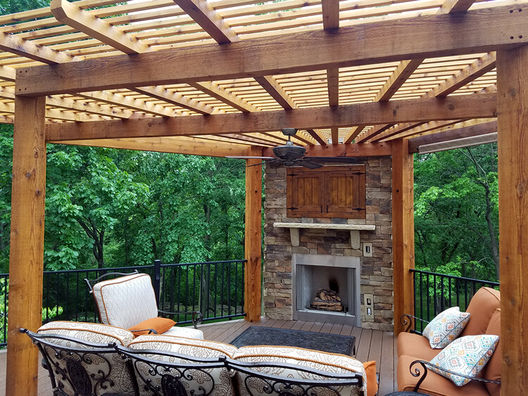 Custom deck with pergola and outdoor fireplace