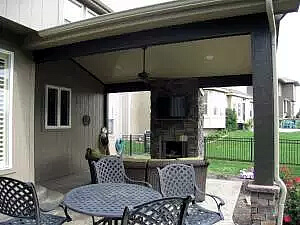 Custom outdoor fireplace on backyard porch