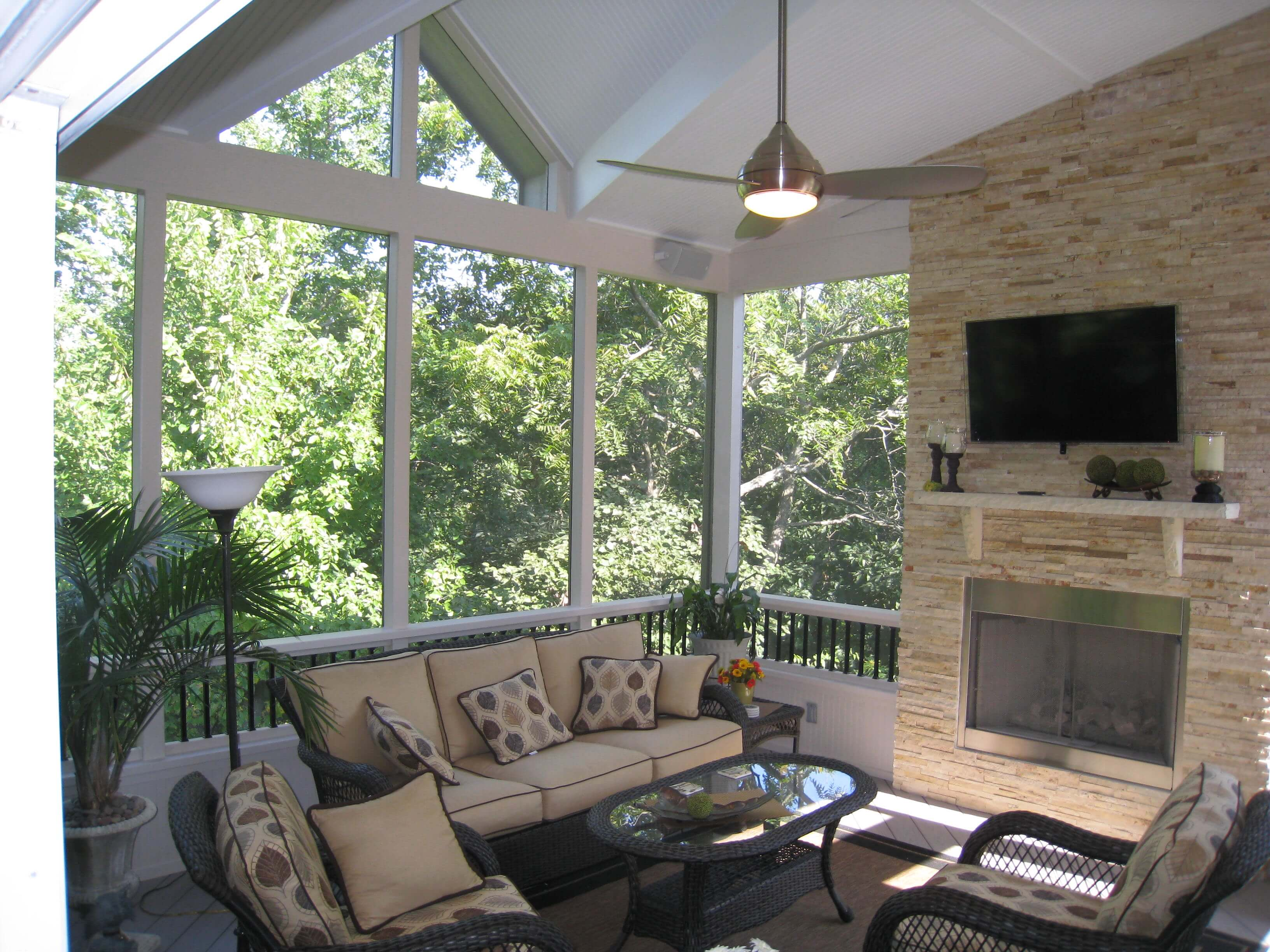 Cozy screened porch with fireplace