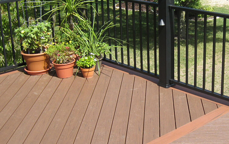 Deck floor details and potted plants by the railing