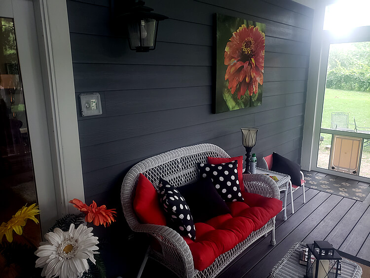 Cozy couch on screened porch