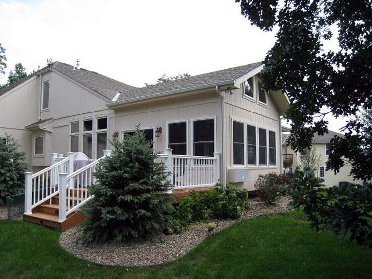 Exterior view of custom sunroom and deck