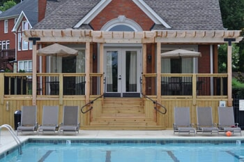Poolside wooden deck with pergola