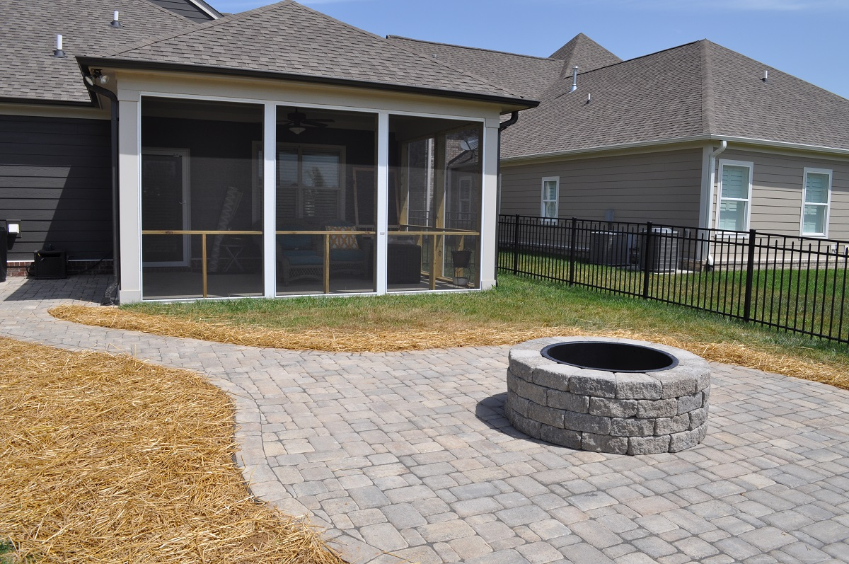 Custom hardscape with fire pit and open porch in Franklin TN
