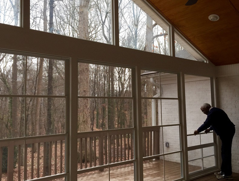 Screened porch looking over the forest.