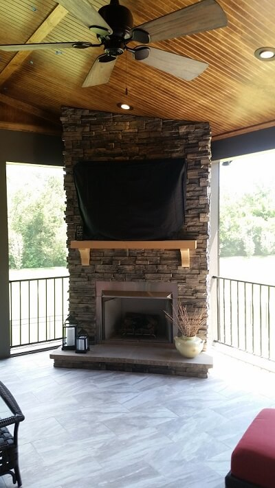 Custom second story porch with fireplace
