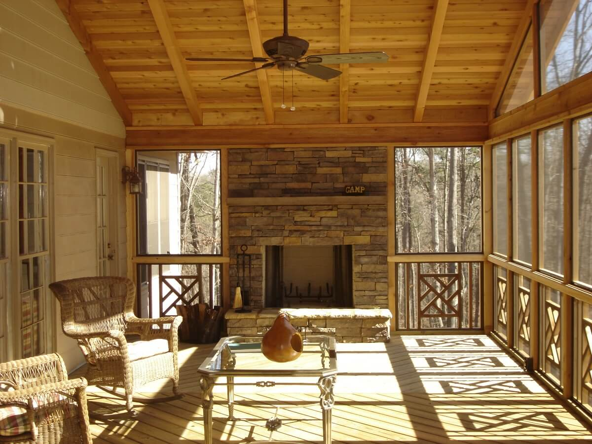 Custom screened porch with outdoor fireplace