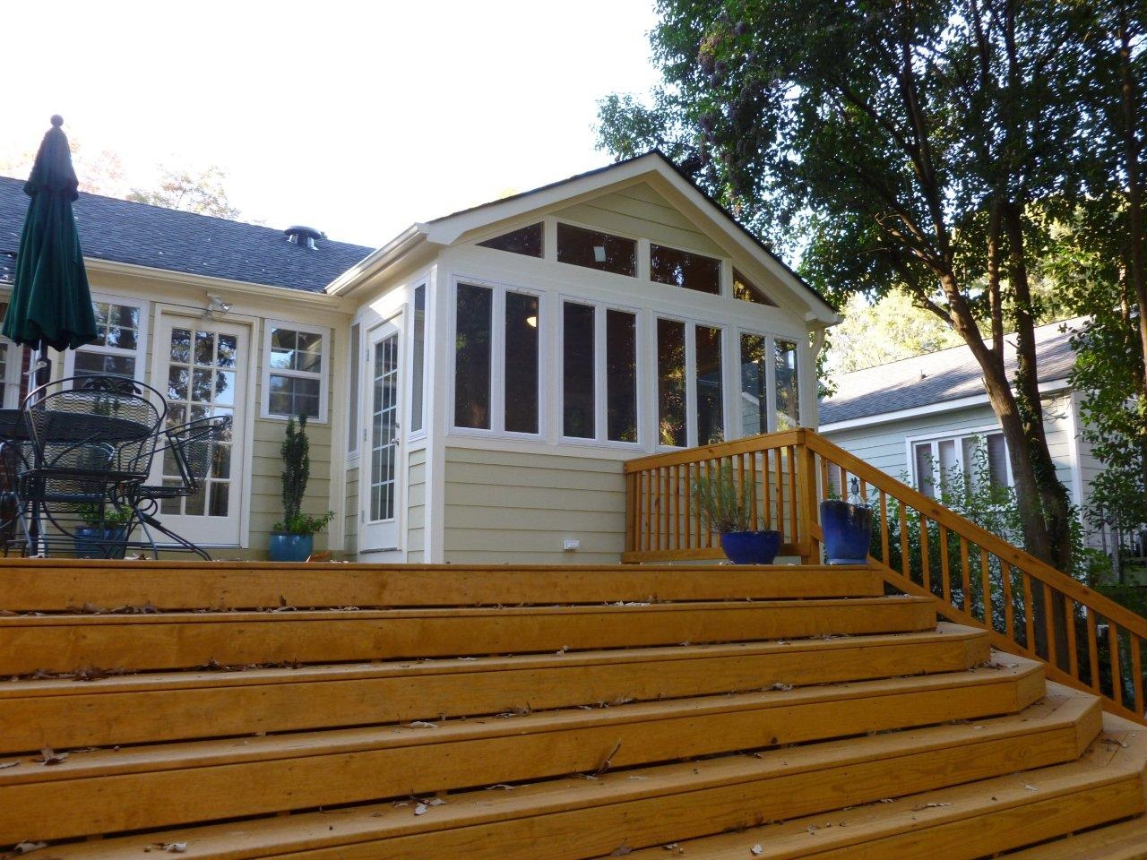 grand wood stairs with sunroom