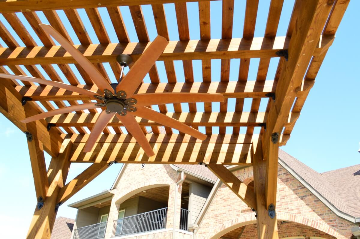 Cedar Pergola with decorative brackets and oversized ceiling fan
