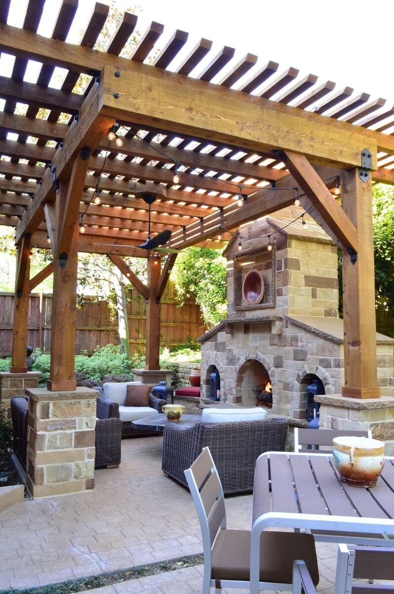 Pergola above seating area and next to outdoor fireplace